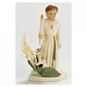 Boy communiant with candle